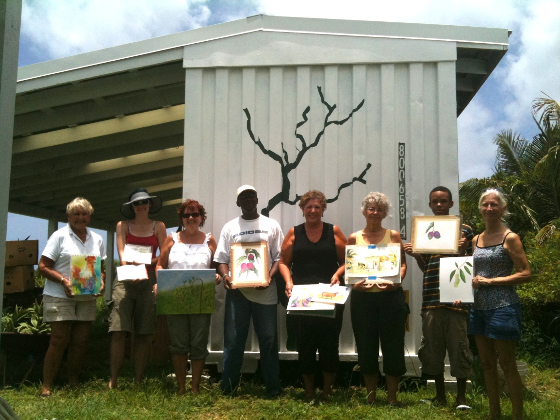 The St. Croix Palletteers group poses at the ARTfarm holding the paintings they created during their visit.