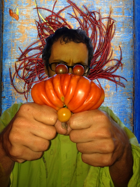 "The so-called ""Tomato Monster"" is made up of a farmer, tomatoes, and string beans."