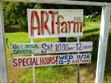 The ARTfarm roadside sign features a new addition describing today's holiday hours.