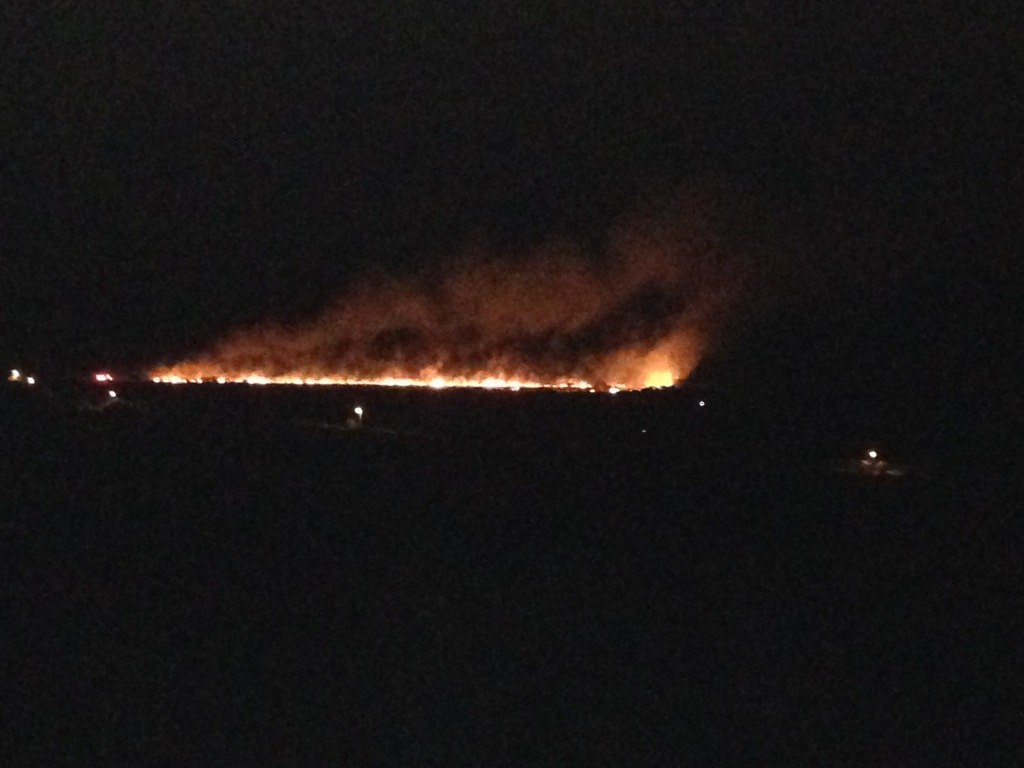 Another shot of the fire as it continued to spread and head south. Our truck is the tiny pinpoint of light close to the west end (right) of the fire line. Above us and closer to the fire is a VIFD truck.