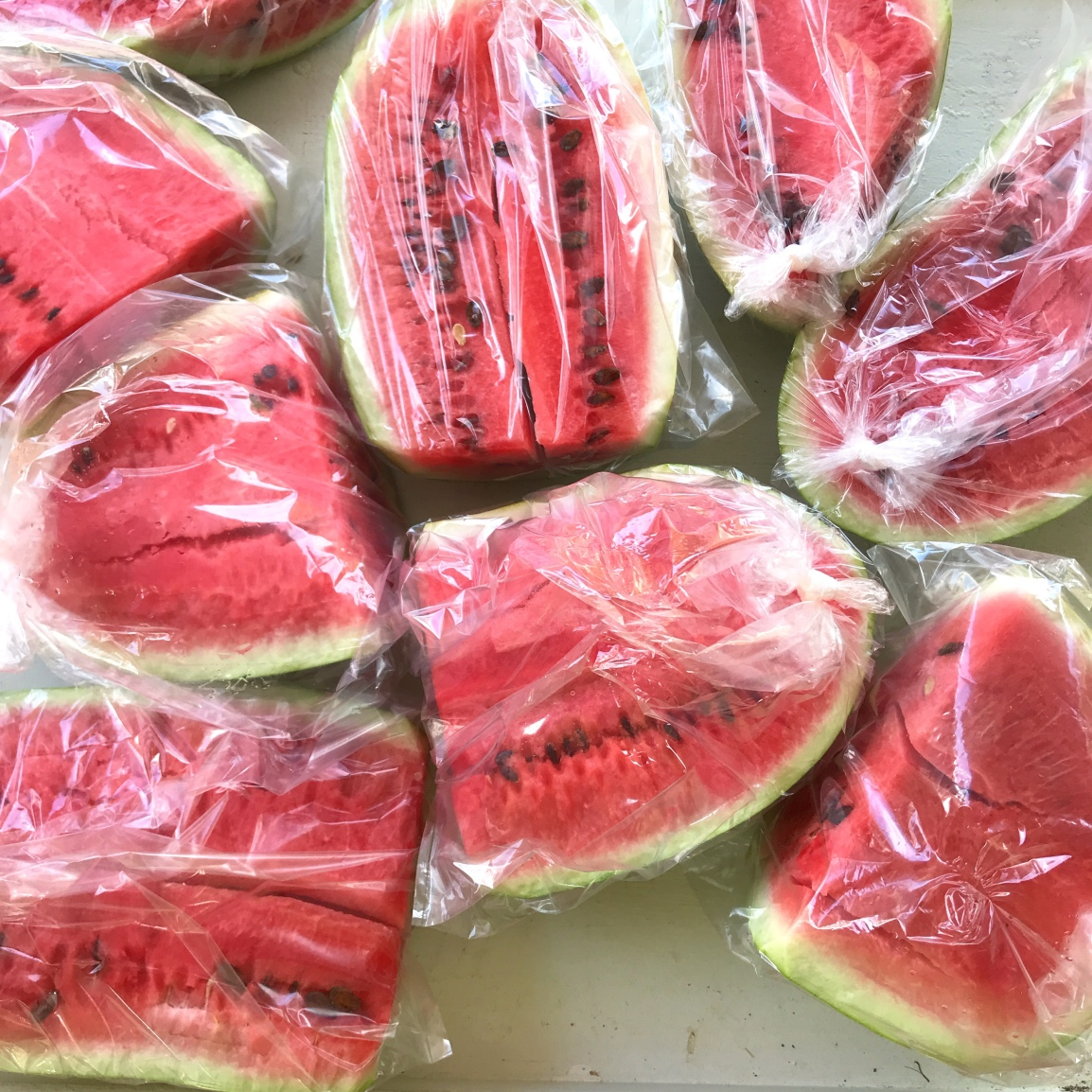 watermelon cut into chunks and bagged in plastic